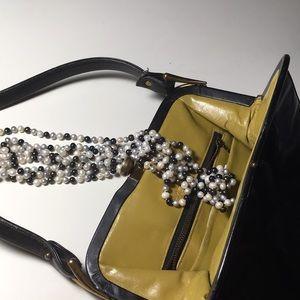 Vintage black patent leather clasp purse